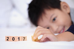Asian boy playing wooden block text 2017.Little cute boy playing Royalty Free Stock Photo