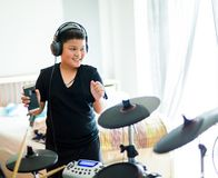 Asian boy put black tshirt and headphone is dancing and learning royalty free stock photo