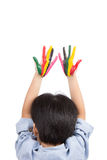 Asian boy raise his colorful hands into the sky Stock Image