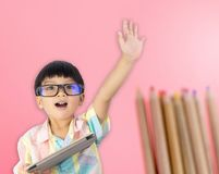 Asian boy raised his hand for question Stock Image