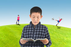 Asian boy reading a book and imagine Royalty Free Stock Photos