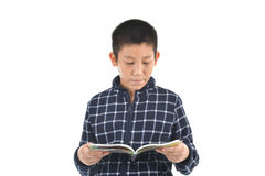 Asian boy reading at book on white background Royalty Free Stock Photos