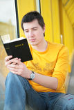 Asian boy  reads bible Royalty Free Stock Image