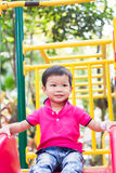 Asian boy relax in the park Royalty Free Stock Photography