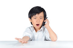 Asian boy resembling business man argumenting Royalty Free Stock Photography