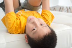 Asian boy resting comfortably on his bed Stock Photo