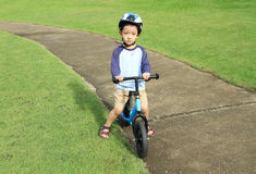 Asian boy riding bicycle Royalty Free Stock Photography