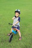 Asian boy riding his bicycle Royalty Free Stock Photography