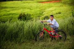 Asian boy riding on his bycicle Stock Photo