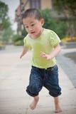 Asian boy run Royalty Free Stock Photos