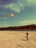 Asian boy running kite - vintage retro style Royalty Free Stock Images
