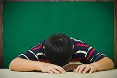 Asian boy's sleeping on a book Stock Photo