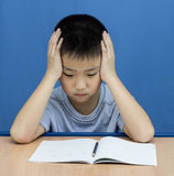 Asian Boy serious read a book Royalty Free Stock Image