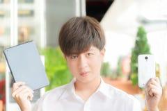 Asian Boy show gadgets Stock Photo