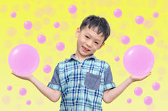 Asian boy showing bubbles on his hands Stock Photo