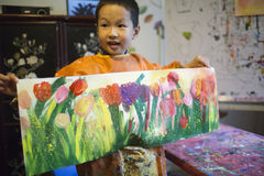 Asian boy showing his tulip painting Royalty Free Stock Photo