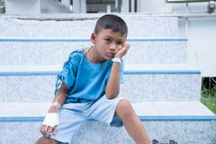 Asian boy sick in hospital. Little asian boy sick in hospital royalty free stock photography