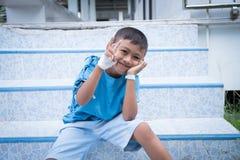 Asian boy sick in hospital. Little asian boy sick in hospital stock photos