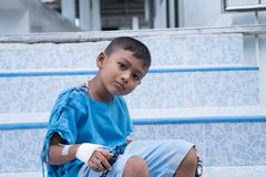Asian boy sick in hospital. Little asian boy sick in hospital royalty free stock images