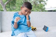 Asian boy sick and sad. Little asian boy sick and sad royalty free stock photography