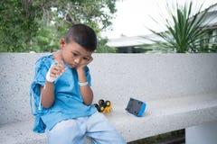 Asian boy sick and sad. Little asian boy sick and sad stock photos