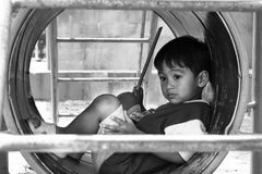 Asian boy sitting alone at playground. Vintage tone Royalty Free Stock Photography