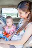Asian boy sitting in the car with his mother Stock Photos