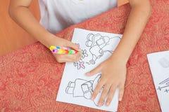 Asian boy Sitting coloring homework Royalty Free Stock Image