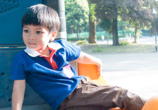 Asian boy sitting in playhouse Stock Image