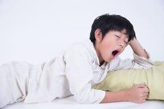 Asian boy sleep. Boy asian cute bed kid sleep sweet relax pyjamas yawn Royalty Free Stock Photography
