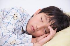 Asian boy sleep. Boy asian cute face young bed kid sleep bedroom sweet relax night dream pyjamas Stock Images