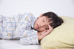 Asian boy sleep. Boy asian little cute young bed kid sleep bedroom people sweet relax night peaceful dream pyjamas Stock Photography