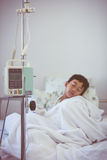 Asian boy sleeping on sickbed with infusion pump intravenous IV Royalty Free Stock Images