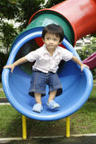 Asian boy on a slide Stock Image