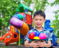 Asian boy smiling at colorful playground Royalty Free Stock Photography