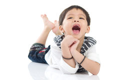 Asian boy. Smiling and lying down on the floor Royalty Free Stock Images