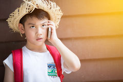 Asian boy speaks by phone Royalty Free Stock Photography