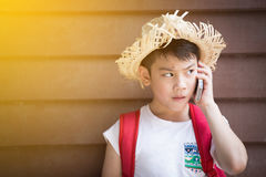Asian boy speaks by phone Royalty Free Stock Image