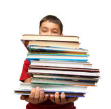 Asian boy with stack of books Stock Photo