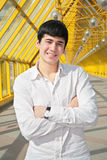 Asian boy stand on footbridge Stock Image