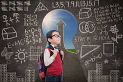 Asian boy standing in class with success road view from keyhole Royalty Free Stock Images