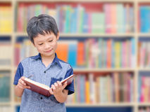 Asian boy student in school library Royalty Free Stock Images