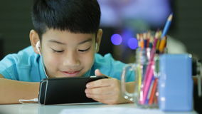 Asian boy in student uniform are painting on a white paper at home stock video footage