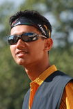 Asian boy in sunglasses. Handsome male Asian teenager in sunglasses and bandanna Stock Photo