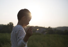 Asian boy in sunset,nice view Royalty Free Stock Photography