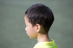Asian boy with sweat hair after sport Stock Photos