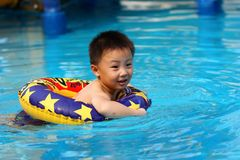 Asian boy is swimming Royalty Free Stock Photography
