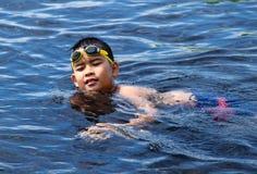 Asian boy swimming Stock Image