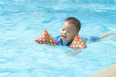 Asian boy swimming Stock Images