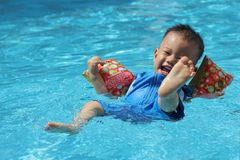 Asian boy swimming Stock Photo